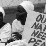 2Liberian women demonstrate at the American Embassy in Monrovia at the height of the the civil war in July 2003_300dpi_credit_Pewee_Flomoku1-600x236