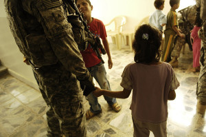 U.S. soldier and Iraqi child.
