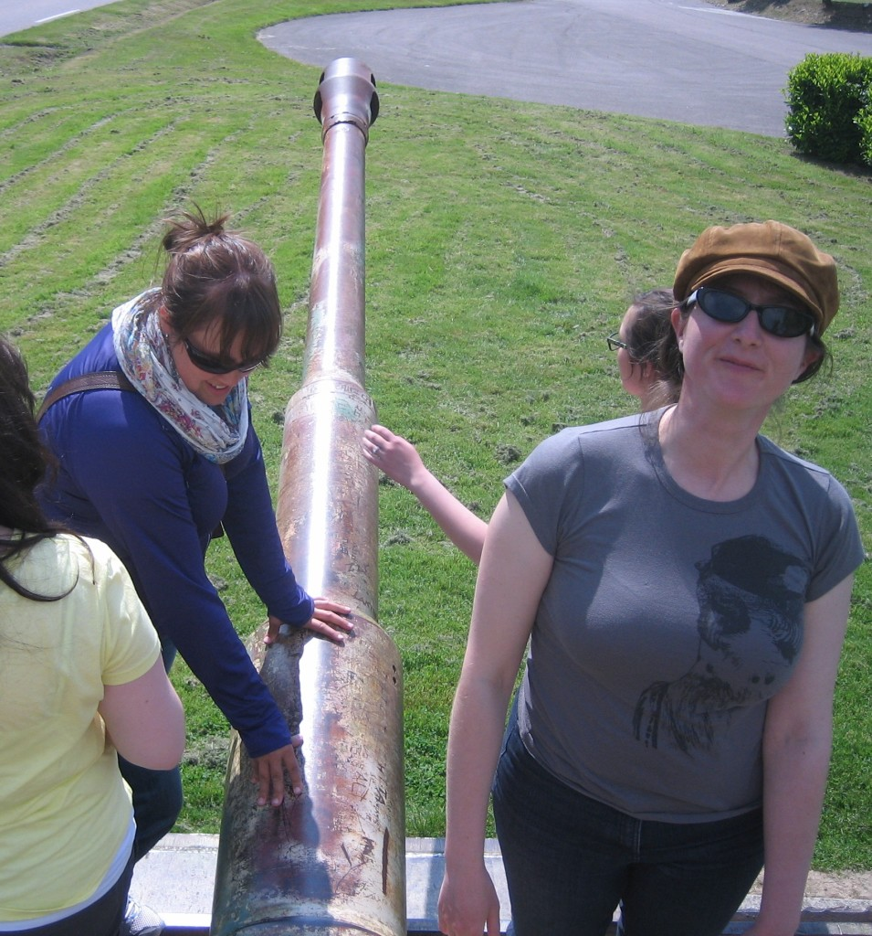Becky Weir and Sanna Guerin size up the main gun on the Tiger tank at Vimoutiers, in Normandy.