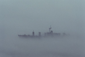 A port beam view of an auxiliary ship taken from the aircraft carrier USS AMERICA (CV 66) during foggy weather conditions, 01/10/1984. Combined Military Service Digital Photographic Files, 1982 - 2007. Found through the Digital Public Library of America.